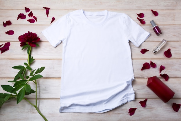 White women cotton t-shirt mockup with red candle and burgundy peony. design t shirt template, tee print presentation mock up
