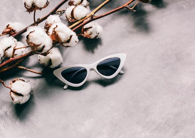 White women's sunglasses glasses in the form of cat eyes
