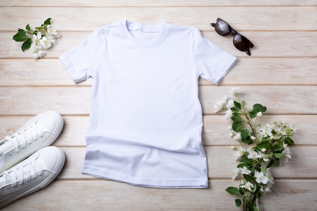 White womens cotton t-shirt mockup with sneakers, sunglasses and apple blossom. design t shirt template, tee print presentation mock up
