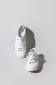 White womens new gumshoes or sneakers on grey