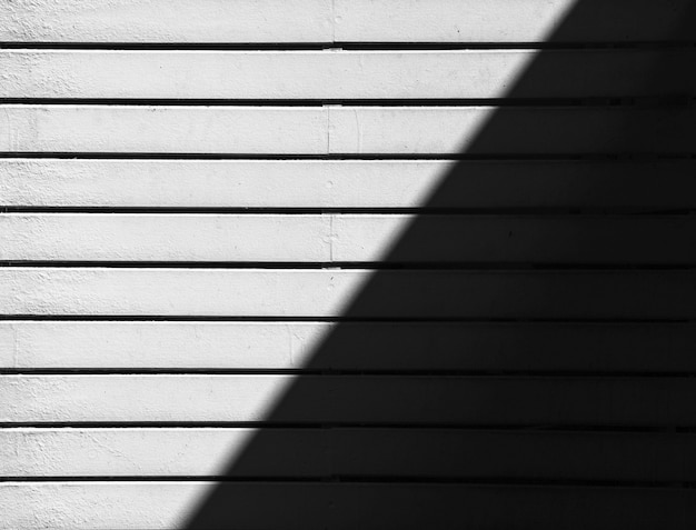 White wood battens wall with light and shadows