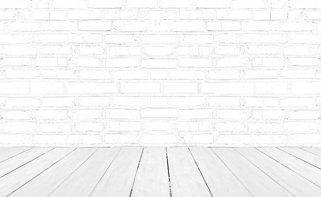 白い木の床とレンガの壁の背景