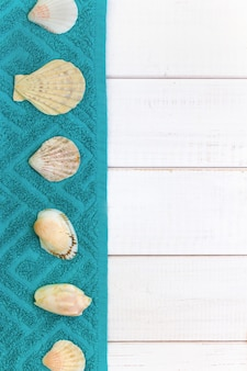 White wooden background, seashells towels