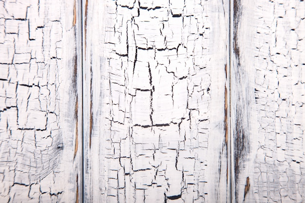 White wooden background with crackling effect