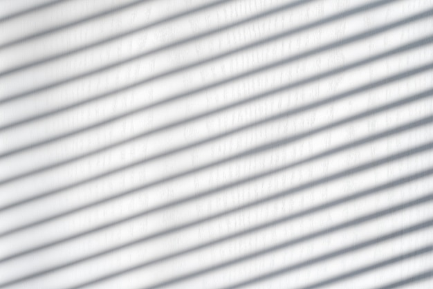 White wooden background with shadow from the blinds. sunny day, interior