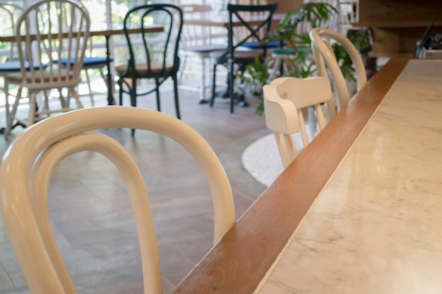 White wooden chairs and clean table