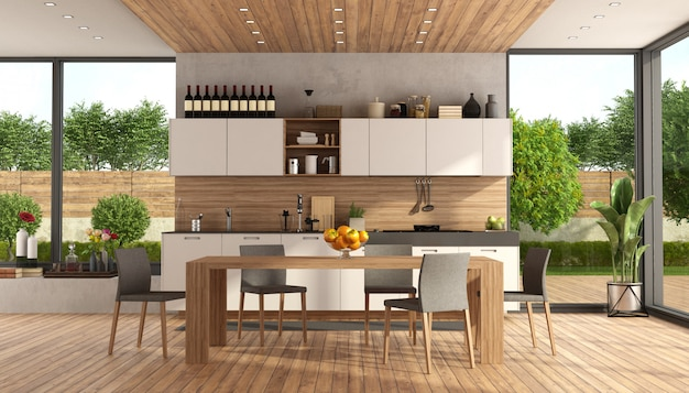 White and wooden modern kitchen with dining table and garden