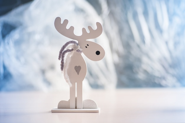 White wooden moose on a light . christmas decorations