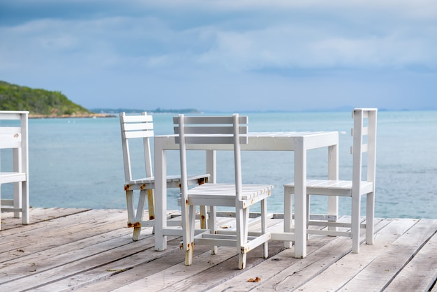 White wooden table and chairs.