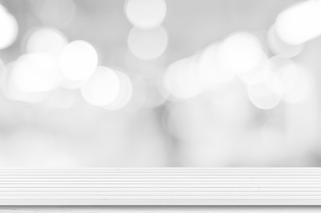 White wooden table top background over blur bokeh light, for product display or montage.