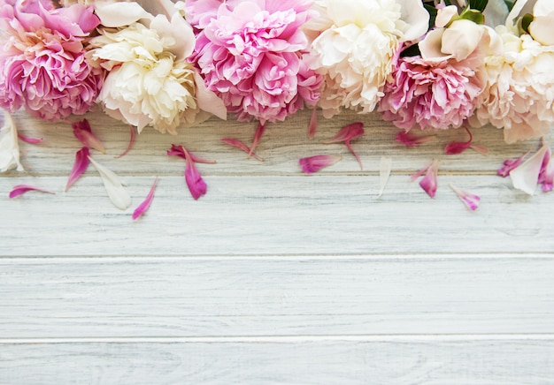 White wooden table with peonies
