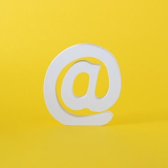 White word at for email and internet messages. word for on line comunication. yellow summer iluuminating background. virtual abstract art.