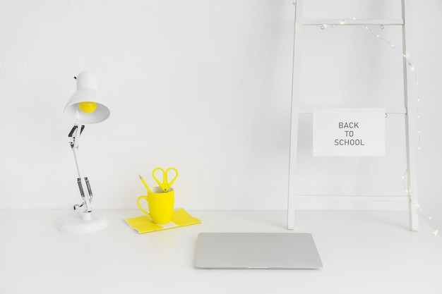 White workplace with yellow mug