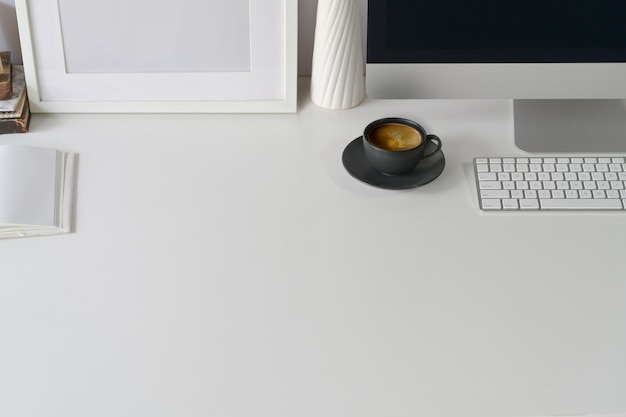White workspace office supplies and copy space