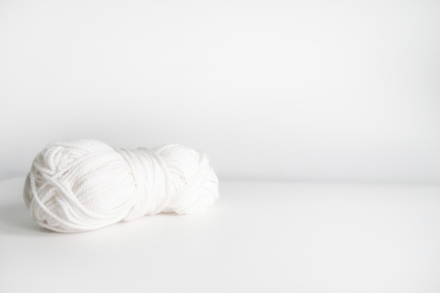 White yarn. skein of wool boho logo.