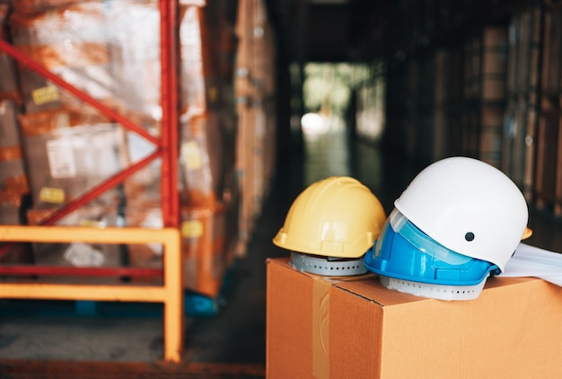 White, yellow and blue hard safety helmet hat for safety protection of workman as engineer or worker in warehouse industry