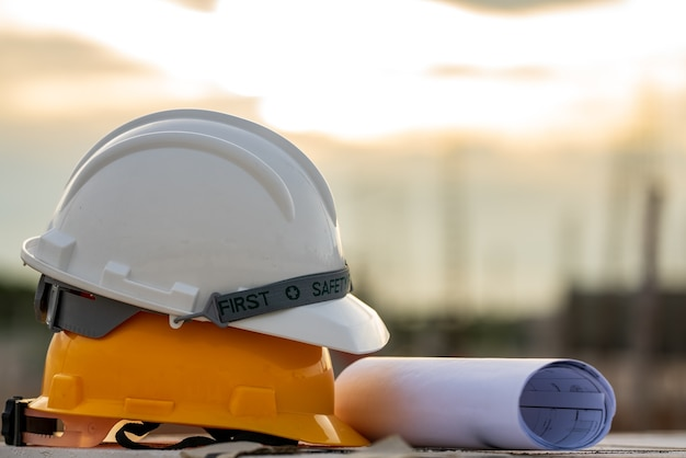 White and yellow helmet hard hat safety in site construction,concept safety first.