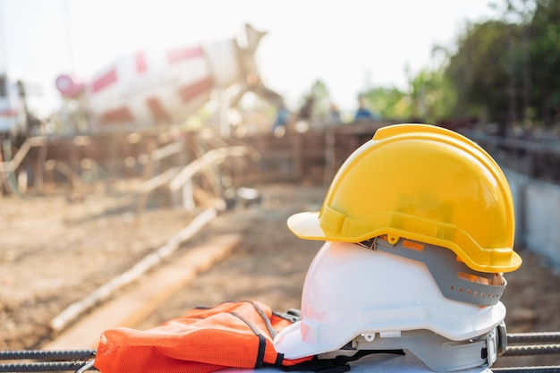 White and yellow helmet on steel in construction site