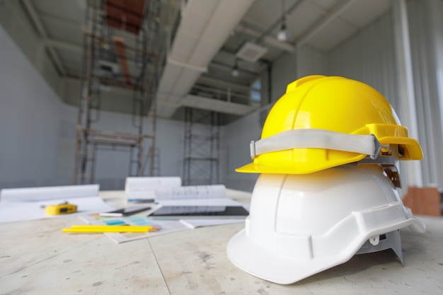 White and yellow safety helmet in construction site