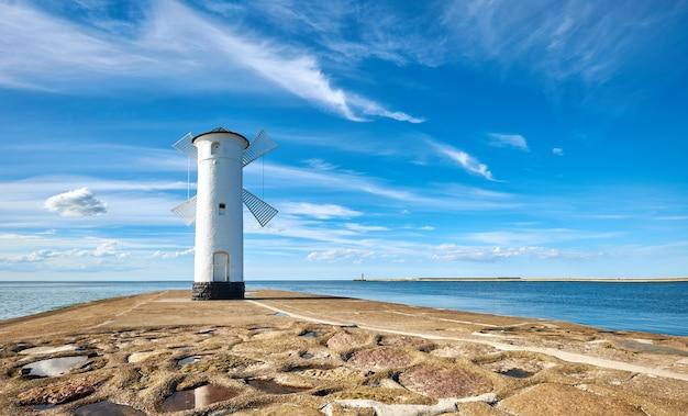 Whitewashed windmill lighthouse in swinoujscie