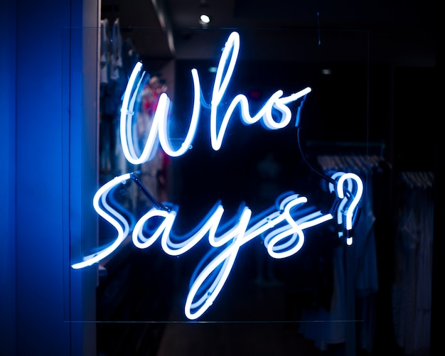 Who says? quote sign in neon lights