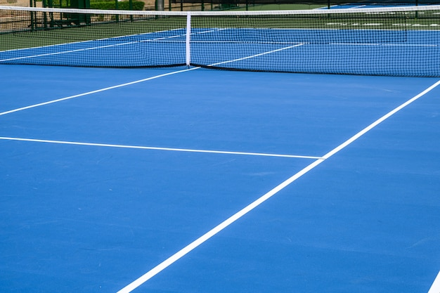 Whole blue tennis court, synthetic rubber lawn