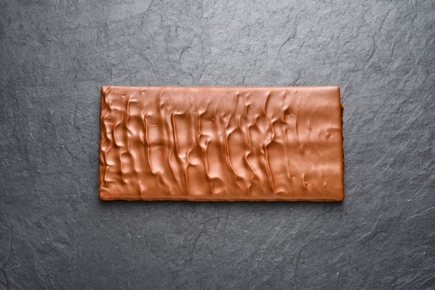 Whole brown milk chocolate bar top view