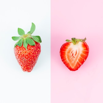 Whole and chopped strawberry on different backgrounds