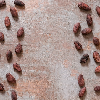 Whole cocoa beans on rustic background