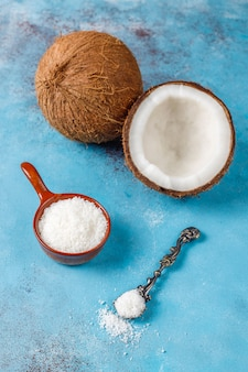 Whole coconut and various pieces of coconut