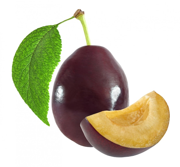Whole and cut dark plum with leaf isolated on white background with clipping path