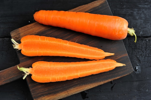 Whole and cut in half carrot close-up