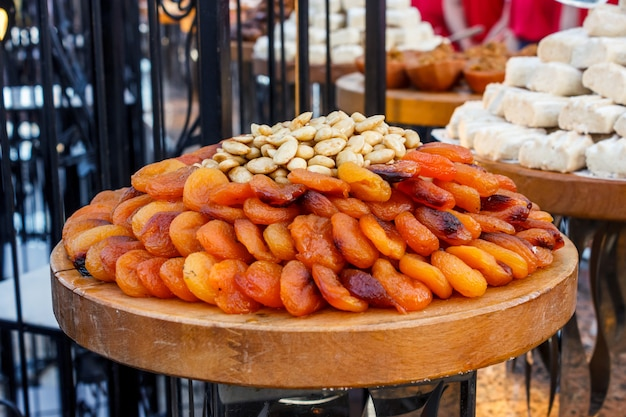 Whole dried apricots with nuts in pottery