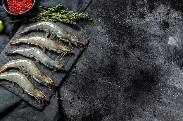 Whole fresh raw giant shrimps, prawns. top view. copy space