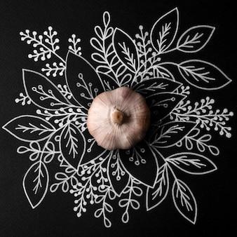 Whole garlic over outline floral