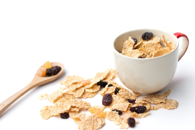 Whole grain cereal flakes which mixed berry fruit and raisins for breakfast isolaed
