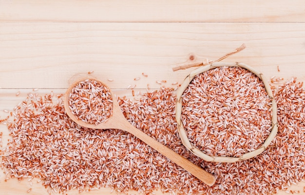 Whole grain rice for healthy and clean food on wooden background .
