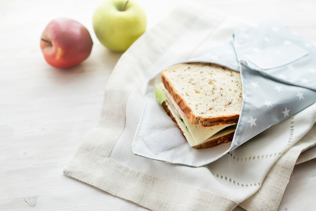 Whole grain sandwich wrapped in reusable bag zero waste ecologic concept