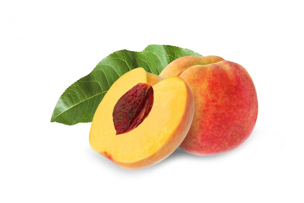Whole and half peach with stone and leaf isolated