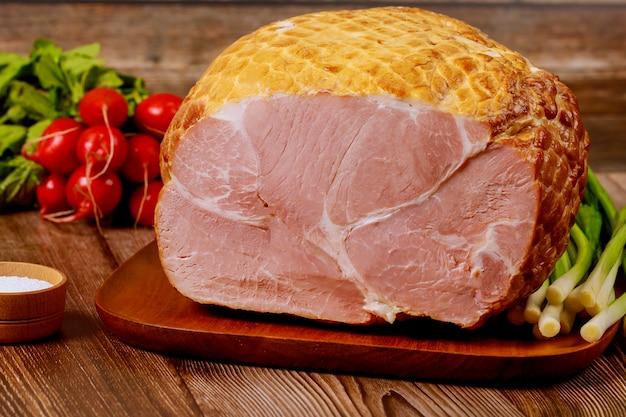 Whole ham with radish, scallion and salt.