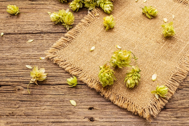 Whole hops on wooden old table. brewery. beer ingredients. cones of hops on vintage boards