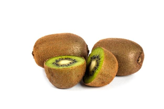 Whole kiwi fruits and half kiwi fruits on white.