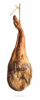 Whole leg of spanish iberian serrano ham hanging on a rope. isolated