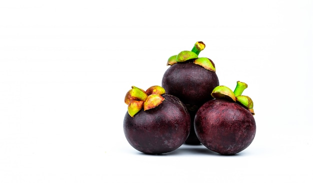 Whole mangosteen showing purple skin with space