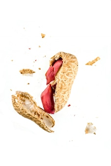 Whole and open peanut nuts