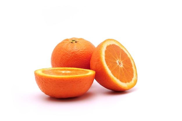 Whole orange fruit and slices