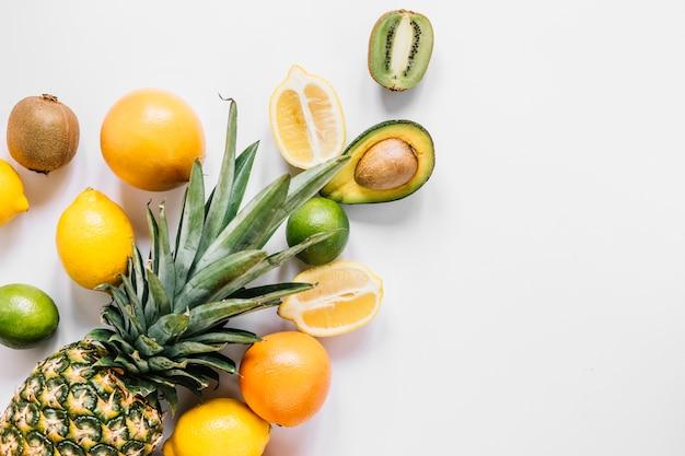 Whole pineapple near fruits