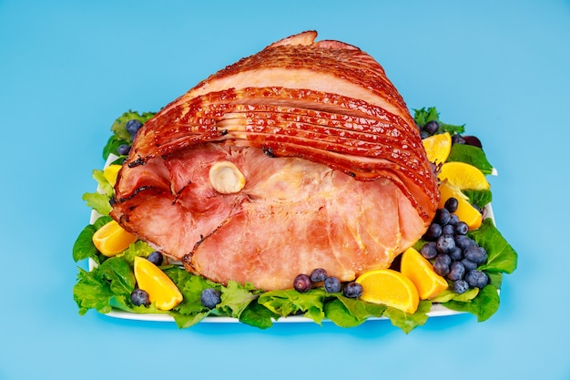 Whole pork ham with fresh fruits. healthy food. easter meal.