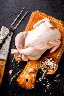 Whole raw chicken with herbs and spices