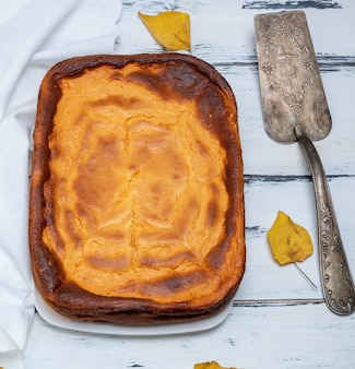 Whole rectangular pie of cottage cheese and pumpkin